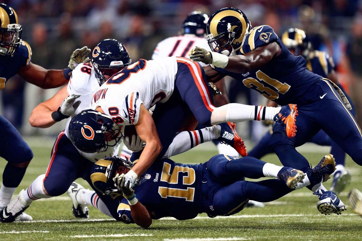 Marc Mariani, #80 of the Chicago Bears, is tackled by Bradley Marquez, #15 of the St. Louis Rams, in the first quarter at the Edward Jones Dome on Nov 15, 2015 in St Louis, Missouri.
