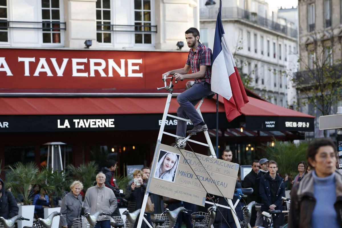 A man, who is awaiting news of his cousin after the Nov 13 attack on the Bataclan music hall, on a bike at the Place de la Republique in Paris on Nov15, 2015.