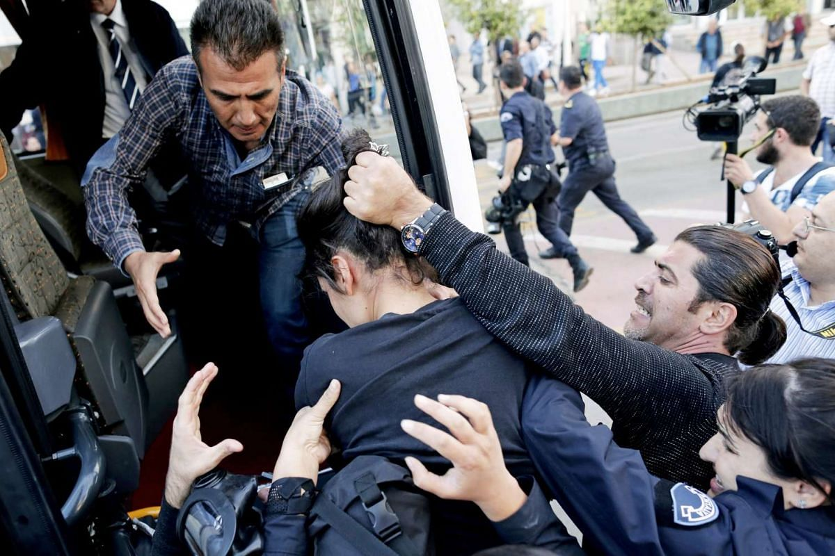The Turkish police detaining protesters during a demonstration against the G-20 summit in Antalya on Nov 15, 2015.
