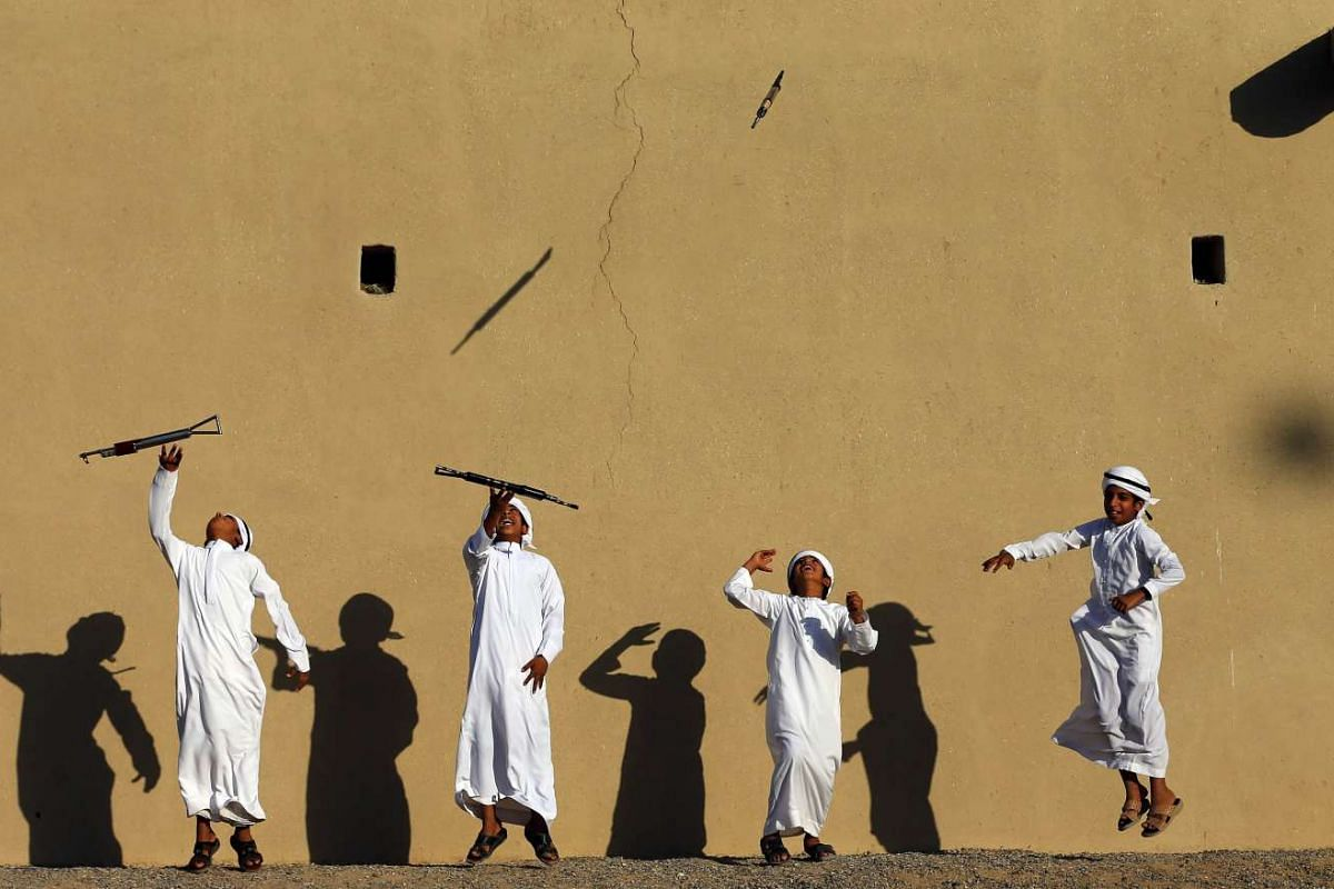 Children practice a traditional dance for the celebrations of the upcoming 44th anniversary of the establishment of the United Arab Emirates, in Sharjah on Nov 16, 2015.