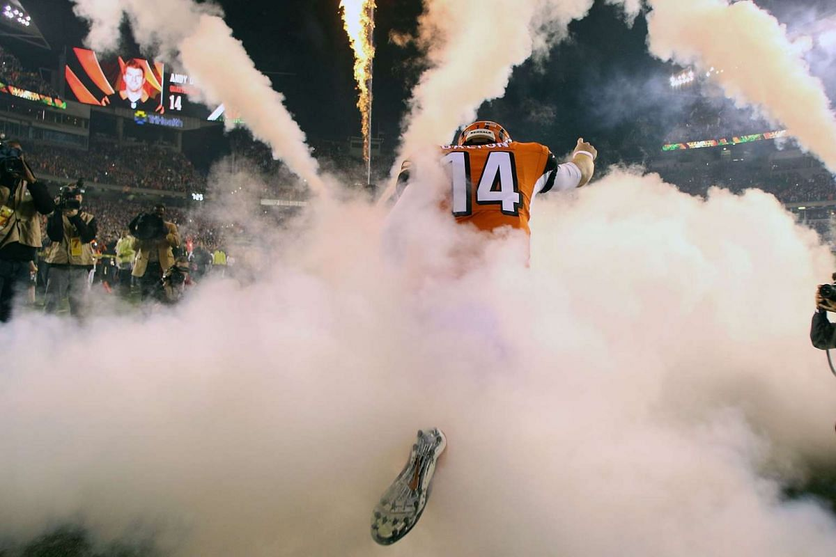 Andy Dalton of the Cincinnati Bengals runs on to the field prior to the start of the game against the Houston Texans at Paul Brown Stadium in Cincinnati, Ohio, Nov 16, 2015.