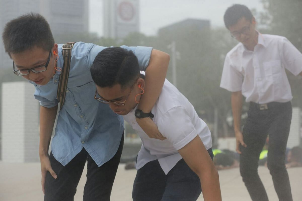 """Office workers affected by the """"explosion"""" during the second scenario at Esplanade Park."""