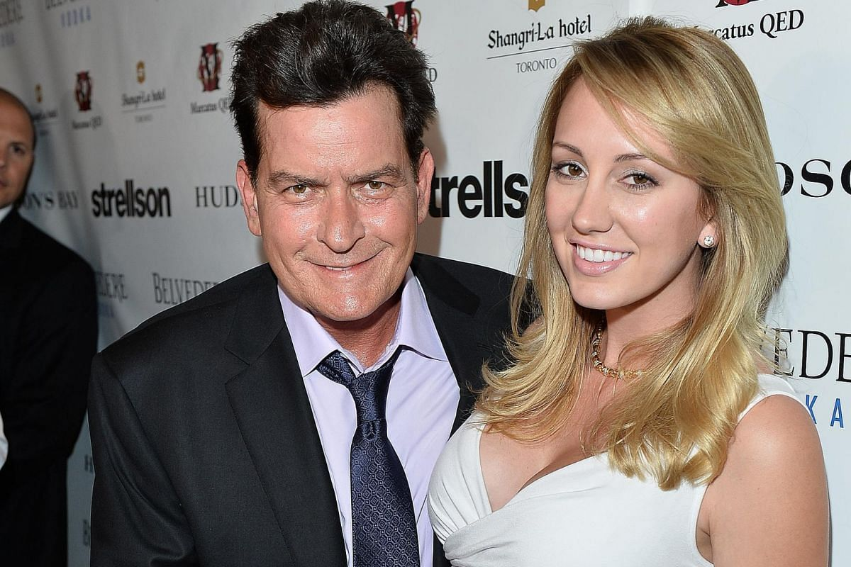 Charlie Sheen with former girlfriend and porn actress Brett Rossi (both above).