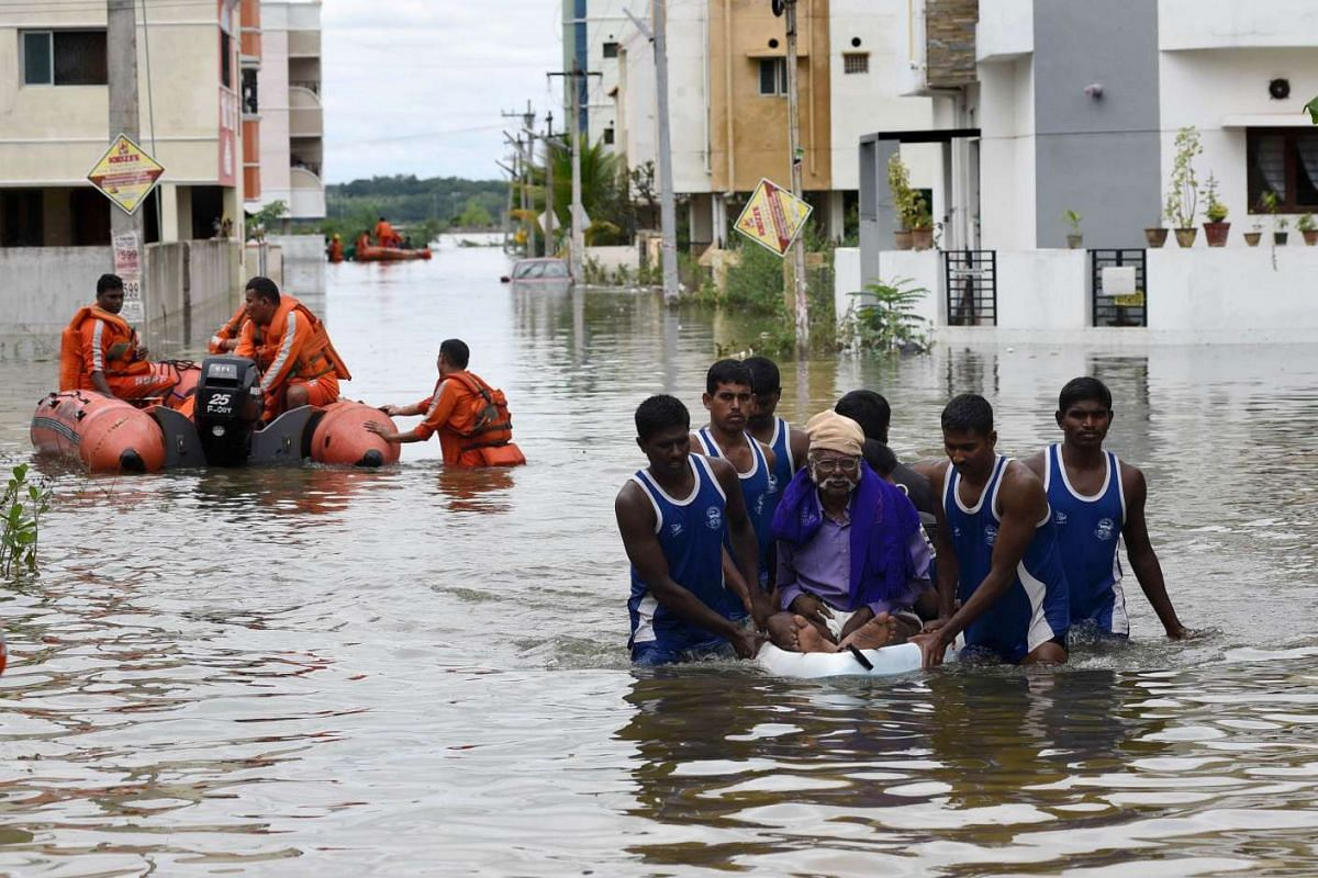 National Disaster Response Force (NDRF) rescue flood affected people during their relief operations in rain-hit areas on the outskirts of Chennai on November 17, 2015. PHOTO: AFP