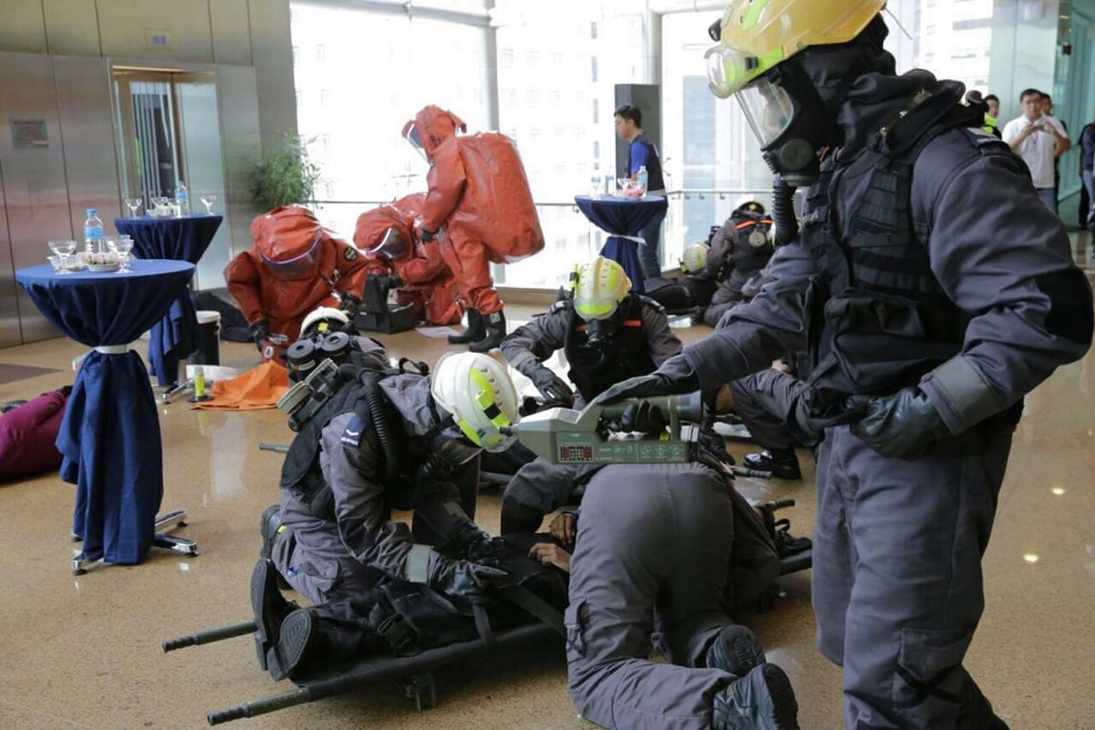 SCDF personnel and hazmat specialists arriving at One Marina Boulevard during one of the scenarios simulating a chemical agent attack.