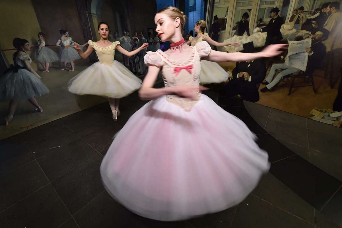 Prima ballerinas from the Australian Ballet performing in front of Edgar Degas paintings at the National Gallery of Victoria in Melbourne, Australia, on Nov 18, 2015. PHOTO: EPA