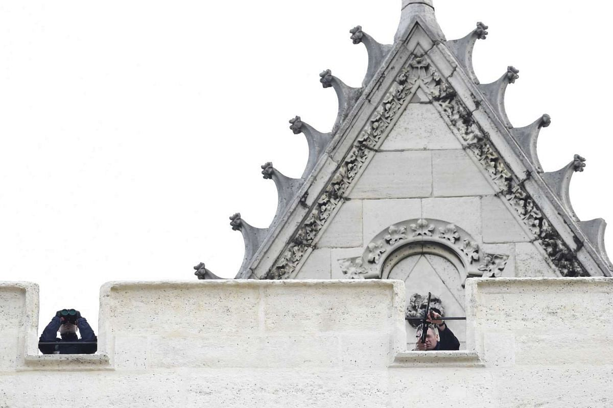 Snipers of the French police on the roof of a church in the northern Paris suburb of Saint-Denis city centre, on Nov 18, 2015. PHOTO: AFP