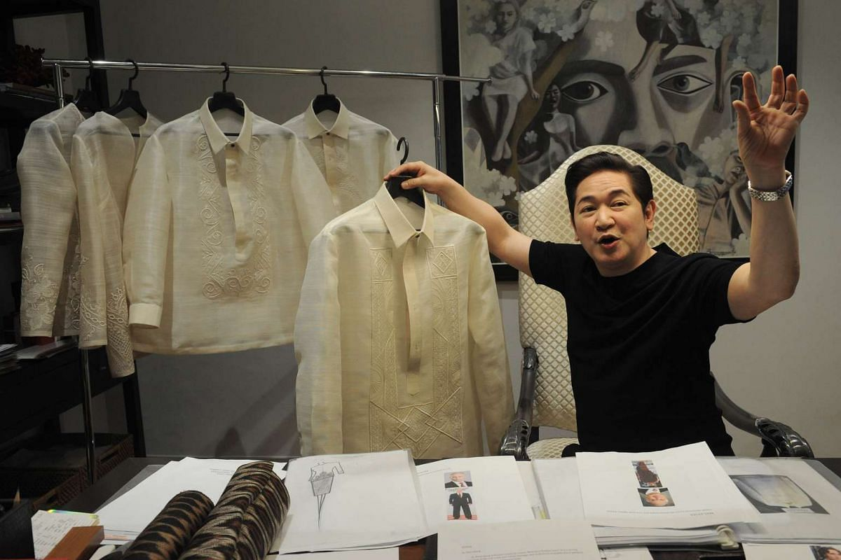 Filipino designer Paul Cabral explaining how he designed the barong or formal shirts.