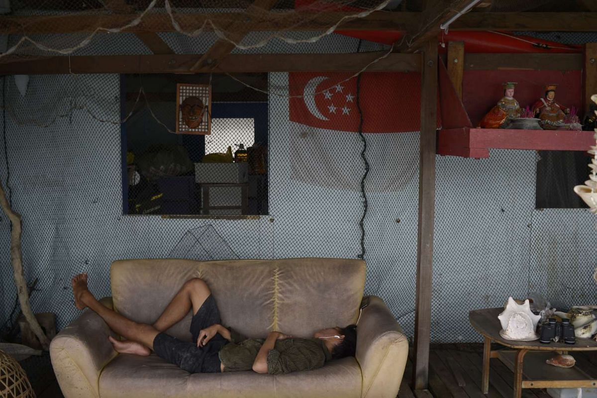 Mr Ye Min Tun, 20, taking an afternoon nap during his lunch break. Workers start their duties early in the morning at about 8am and stop at about 6pm. They get a lunch break in between.