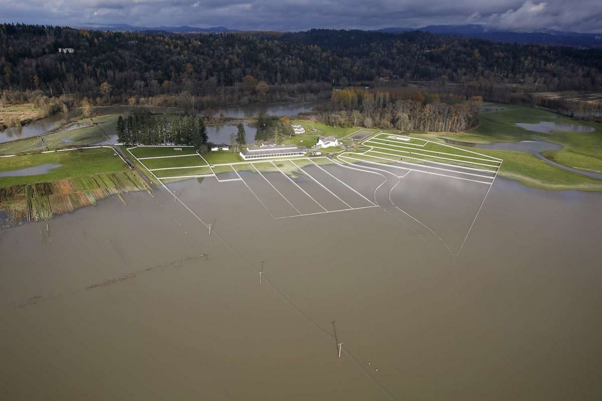The flood waters of the Snoqualmie River cover 284th Ave NE in this aerial photo in Carnation, Washington Nov 19, 2015.