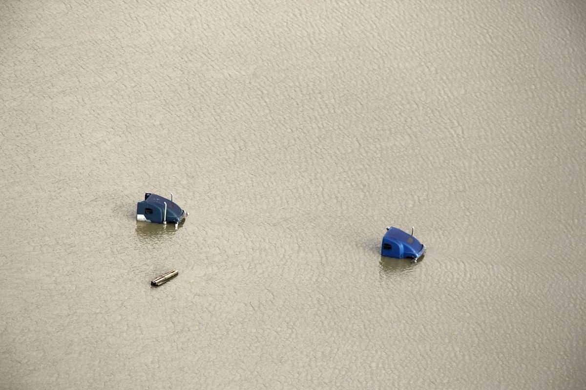 Two semi-trailer truck cabs submerged in the flooded waters of the Snoqualmie River are pictured in this aerial photo in Duvall, Washington Nov 19, 2015.