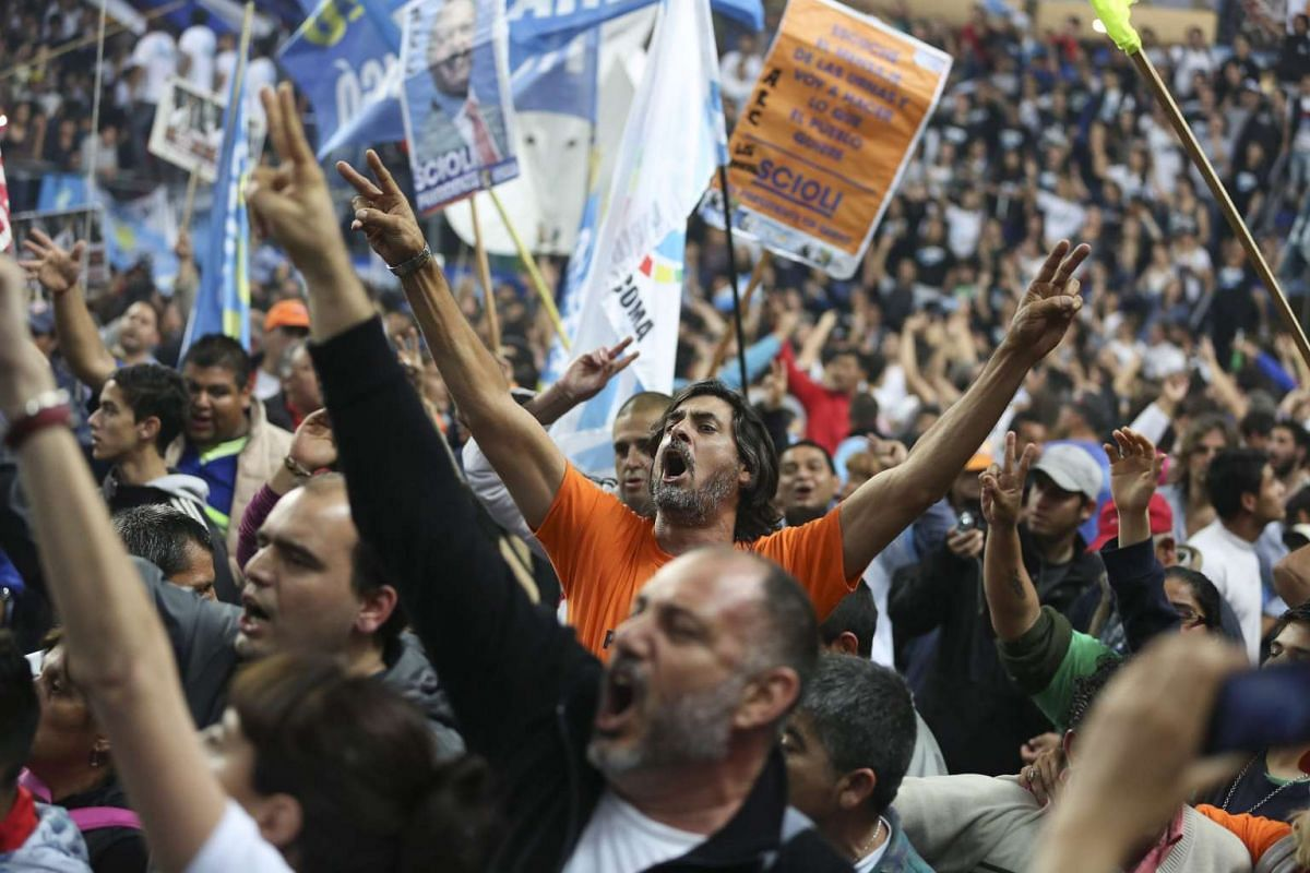 Followers of Argentinian Presidential Candidate, Daniel Scioli, attend his closing campaign event in a sports complex in La Matanza, Buenos Aires province, 19 Nov 2015.