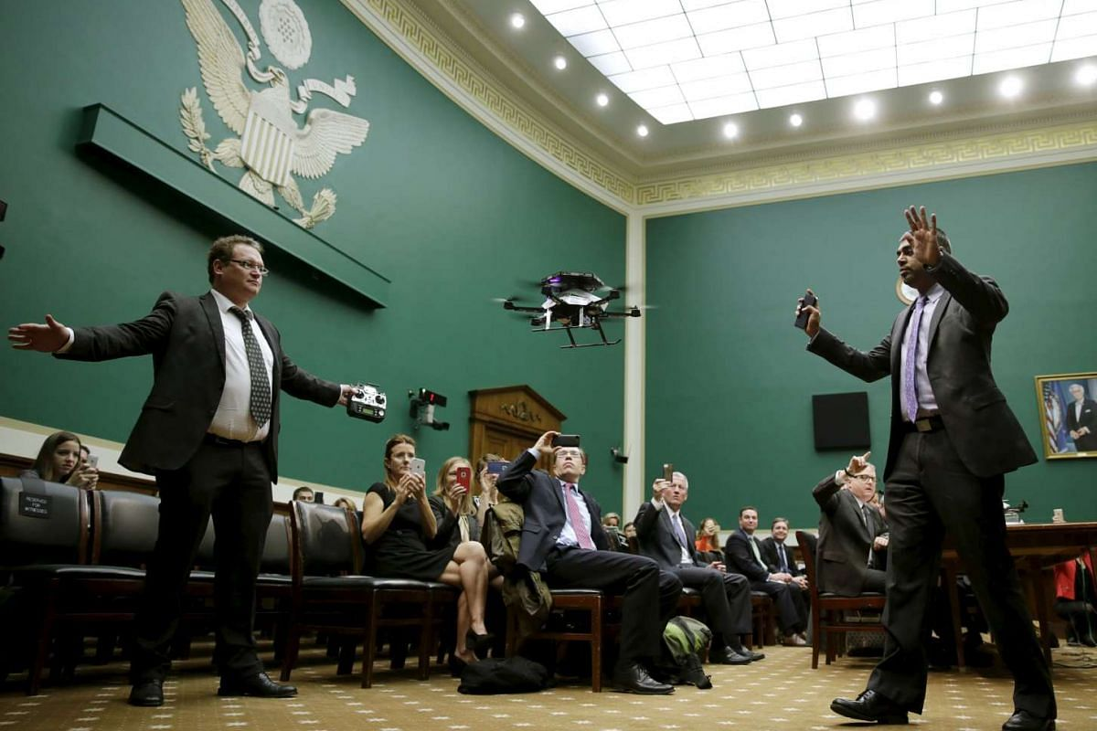 Jan Stumpf (Left) of Ascending Technologies and Anil Nanduri of Intel control an Intel AscTec Firefly drone during a flight demonstration at the House Commerce, Manufacturing and Trade subcommittee on Capitol Hill in Washington Nov 19, 2015.