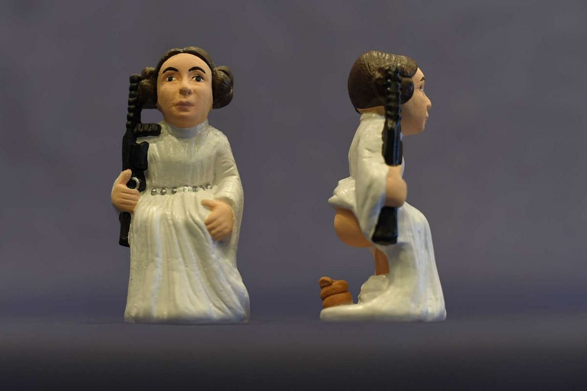 "Ceramic figurines representing Stars Wars' Princess Leia called ""Caganers"" during their presentation in Torroella de Montgri, near Gerona on Nov 19, 2015. Statuettes of well-known people defecating are a strong Christmas tradition in Catalonia, datin"