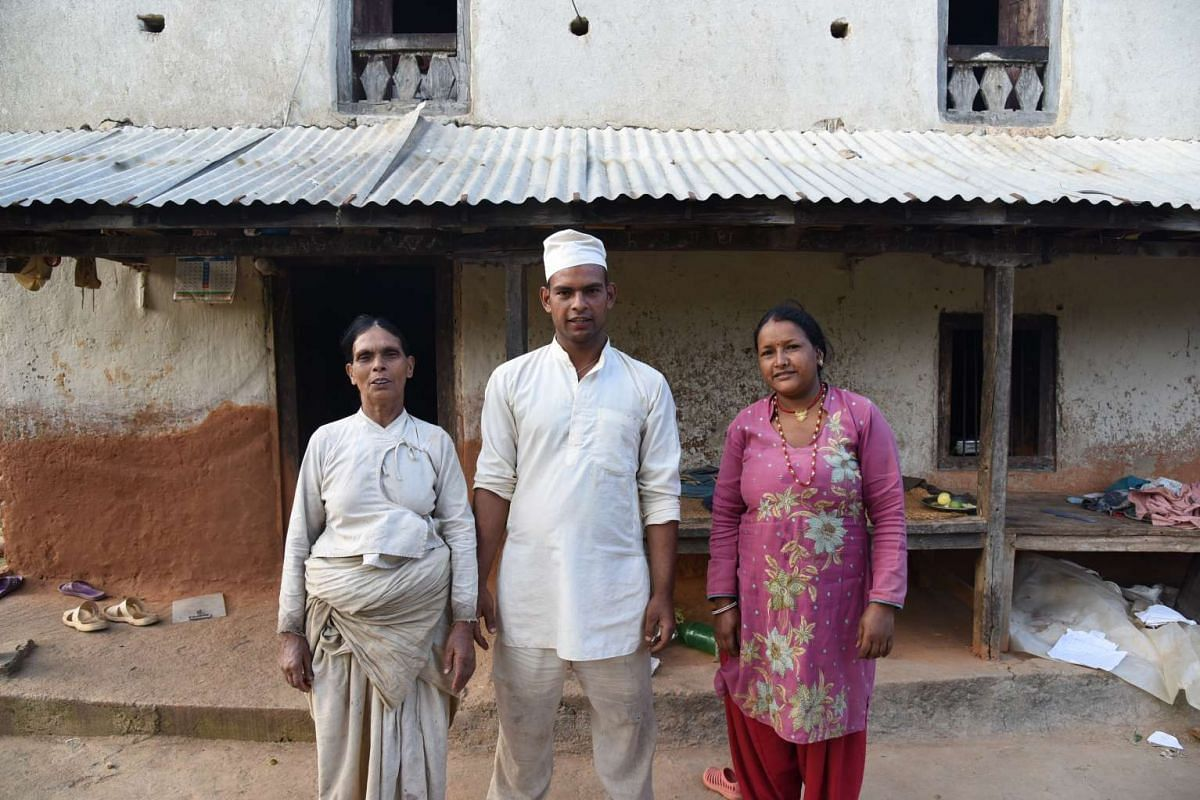 Mrs Santakumari Khanal, 61, her son Dharma Prasad Khanal, 27, and his wife Sabita Khanal, 27, are among the beneficiaries of a shelter that volunteers built during the service trip.