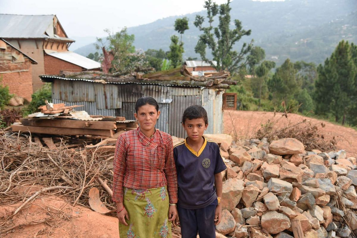 Ms Kamala Shrestha, 32, and her eldest son, Deepak, 12. Their home was ravaged by the earthquake in April. Volunteers paid her a visit and provided her with essential household items.