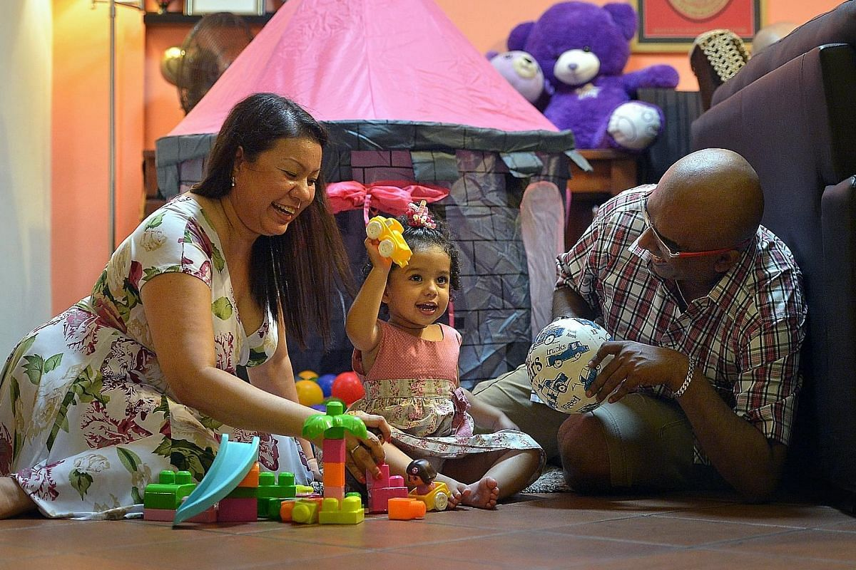 Ms Celeste Rodrigues and Mr Jude De Cunha prioritise playtime with daughter Christie Gabrielle.