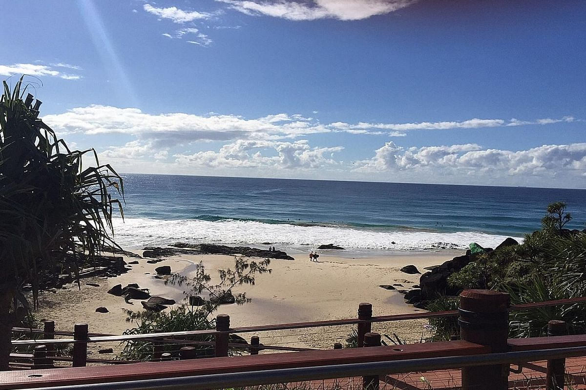 The small, secluded Froggies Beach (top) at the farthest point of Coolangatta, Queensland, is one of Alicia Pan's (above) favourite spots.