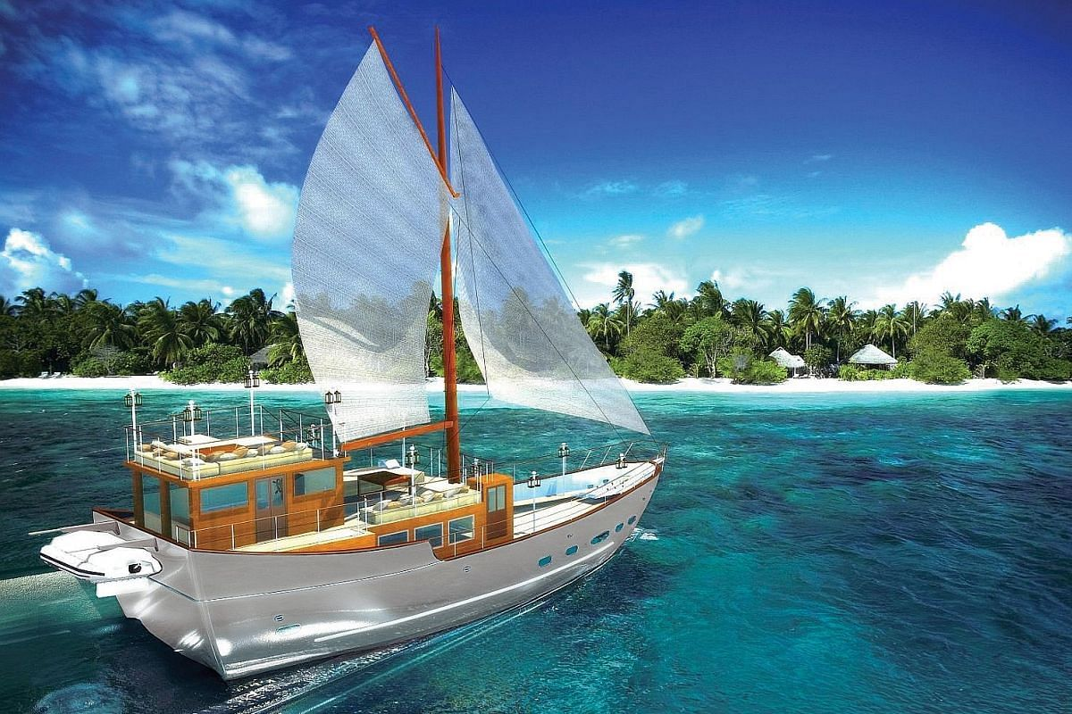 The launch of the Soneva in Aqua (left, in an artist's impression) will take place at the resort Soneva Fushi in the Maldives, where guests can spend the night on a sand bank (above).