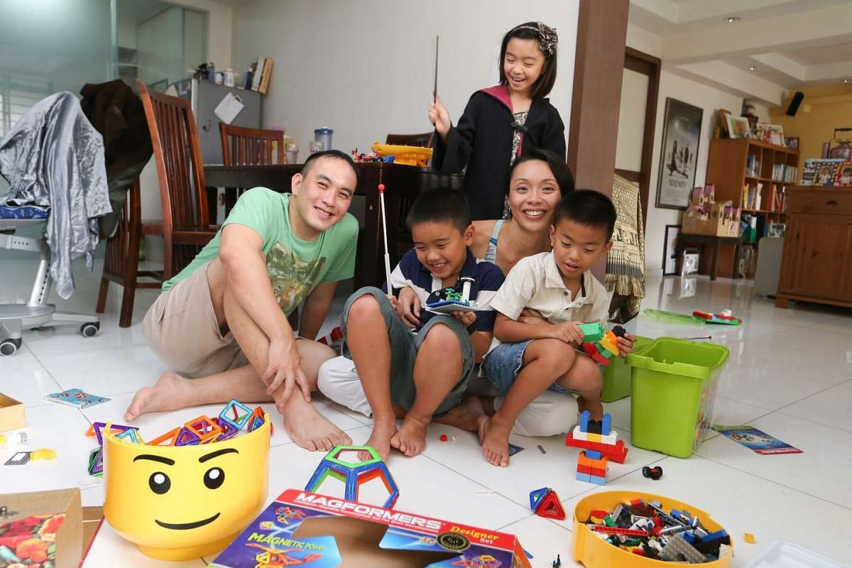 Ms Shereen Ng with her husband Daniel Tan and their children Jordan (standing), Evan (in blue) and Dylan (in khaki). She comes up with ideas for playtime from reading parenting articles.
