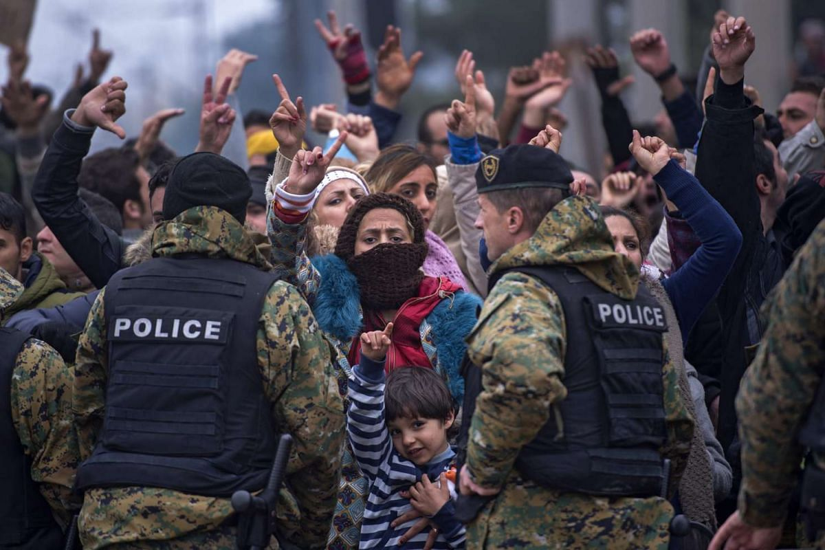 Migrants who are not from Syria, Iraq or Afghanistan protest because they are not allowed to cross the border between Macedonia and Greece, on Nov 21 2015.
