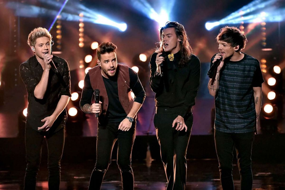 (Left-right) Singers Niall Horan, Liam Payne, Harry Styles, Louis Tomlinson of One Direction perform onstage during the 2015 American Music Awards in Los Angeles, California on Nov 22, 2015