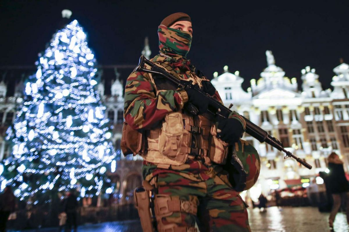 Soldiers patrolling Grand Place, the city's main square, in Brussels, Belgium, as it remains on high alert for the third day on Nov 23, 2015.