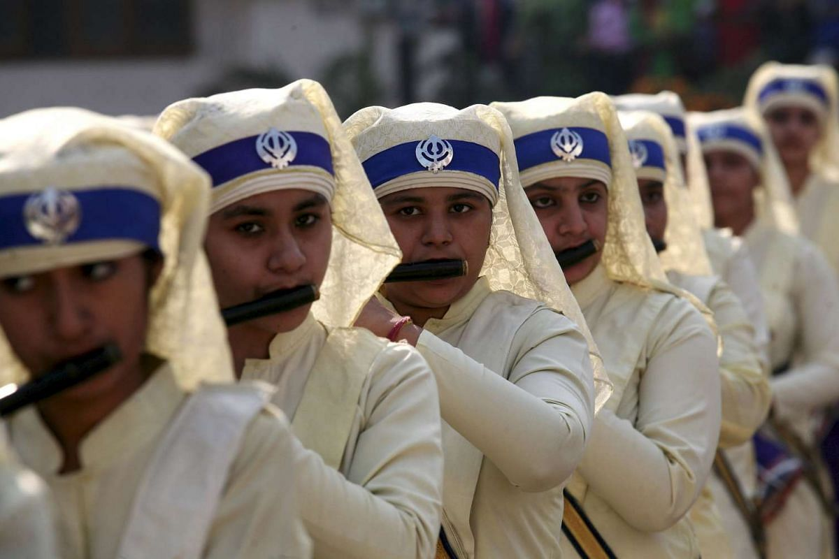 Sikh girls take part in a religious procession on the eve of the 546th birth anniversary of Guru Nanak Dev, the founder of Sikh faith, in Amritsar, India, on Nov 24, 2015.
