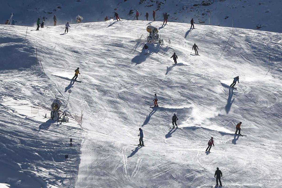 People ski down a slope in the western Austrian ski resort of Obergurgl, Austria, Nov 24, 2015.