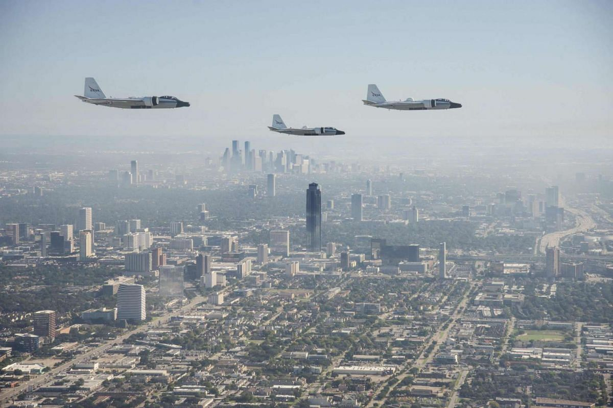 NASA's three WB-57s are seen during their historic formation flight over downtown Houston, Texas, on Nov 19, 2015.