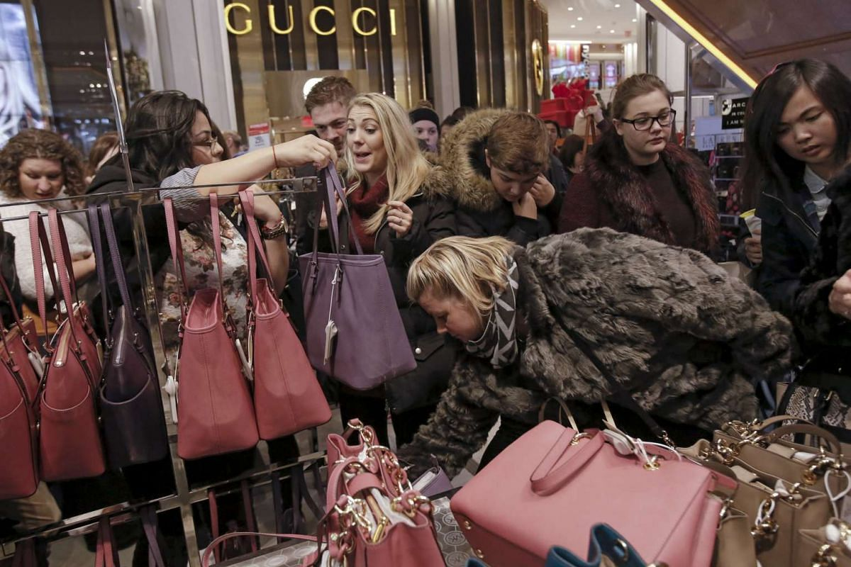 Women shopping for handbags at Macy's Herald Square store during the early opening of the Black Friday sales on Nov 26, 2015.