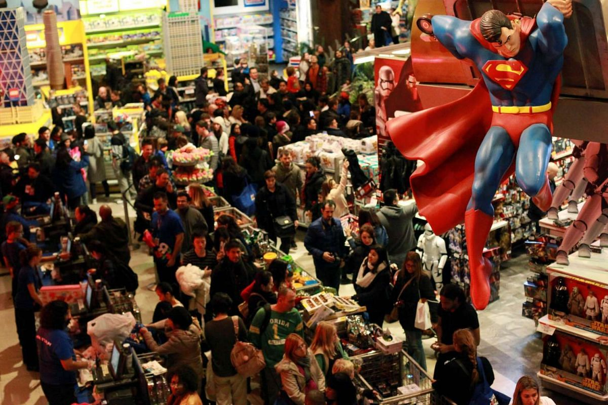 Customers shopping in Toys 'R' Us in Times Square on Thanksgiving evening for early Black Friday sales on Nov 26, 2015.