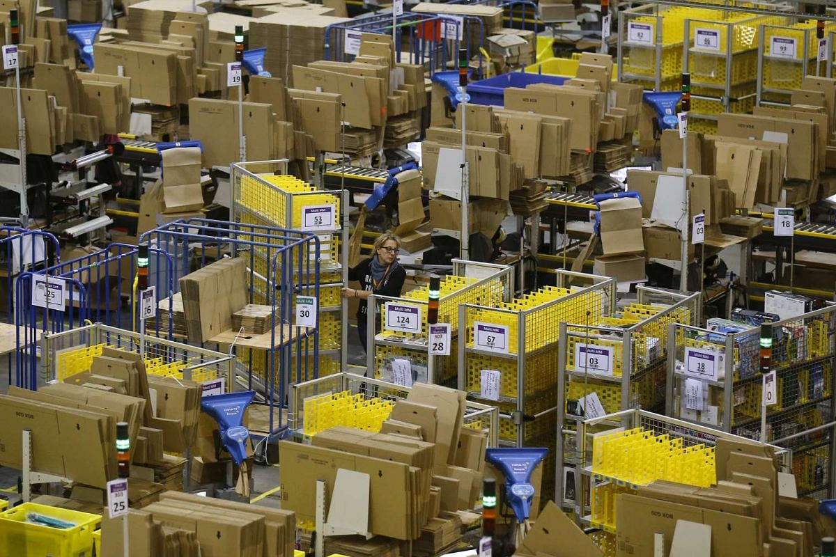 A woman at work during Black Friday deals week at an Amazon fulfillment centre in Madrid, Spain, on Nov 24, 2015.