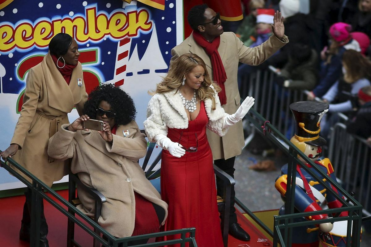 Singer Mariah Carey waves to fans as she goes down 6th Avenue.