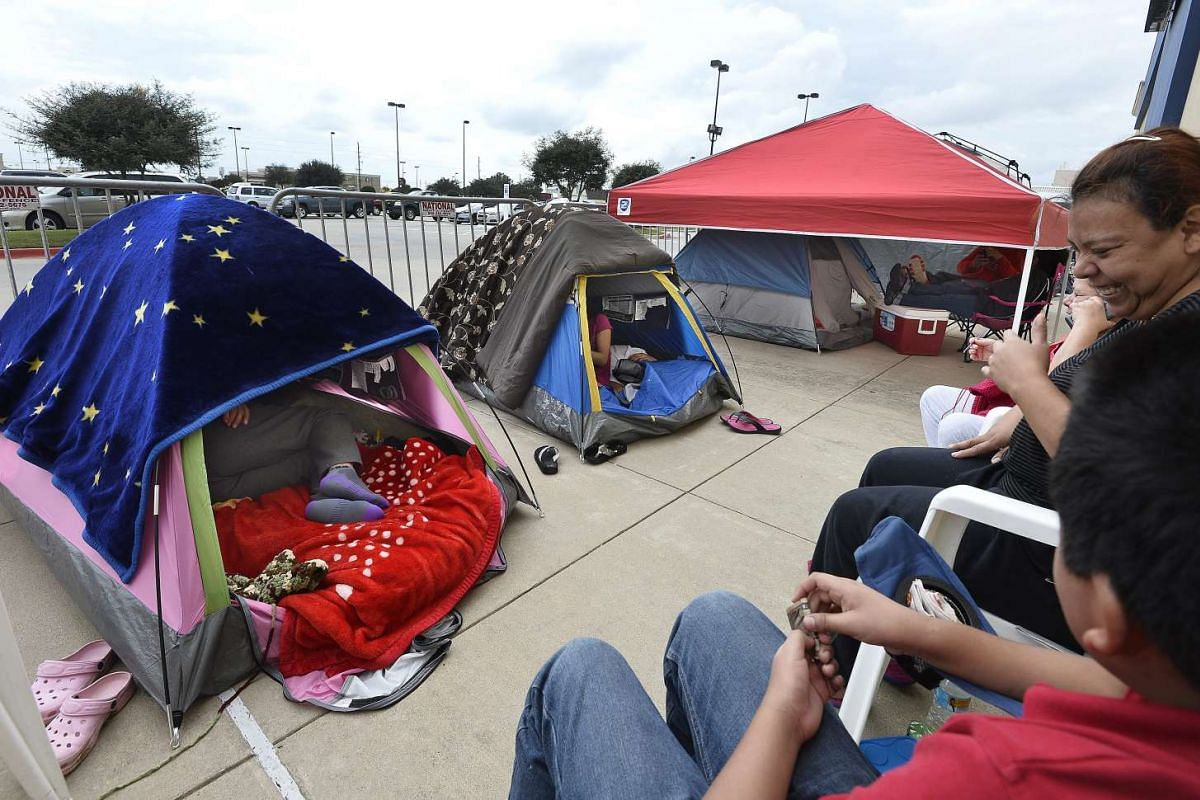 People camping out in tents outside a Best Buy store two days ahead of Black Friday shopping in Rosenberg, Texas, on Nov 25, 2015.