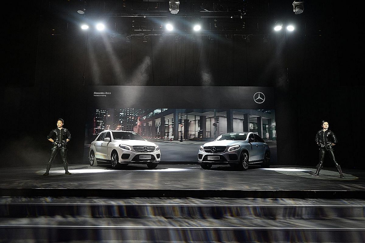 Lexus unleashed its latest RX crossover, the RX200t. The new Mercedes-Benz (above from left) GLE and GLE Coupe being unveiled at Capitol Theatre and Jaguar's XF executive sedan (left).