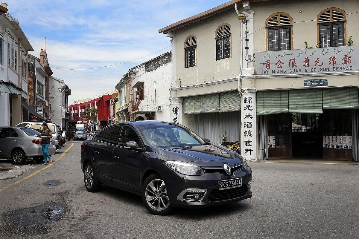 The Renault Fluence (far left) and Renault Clio (left) in Penang, where the Clio navigated Georgetown's narrow one-way streets effortlessly. Both the Fluence (far left) and Clio (left), crossing Penang Bridge, fared well in their range and fuel consu