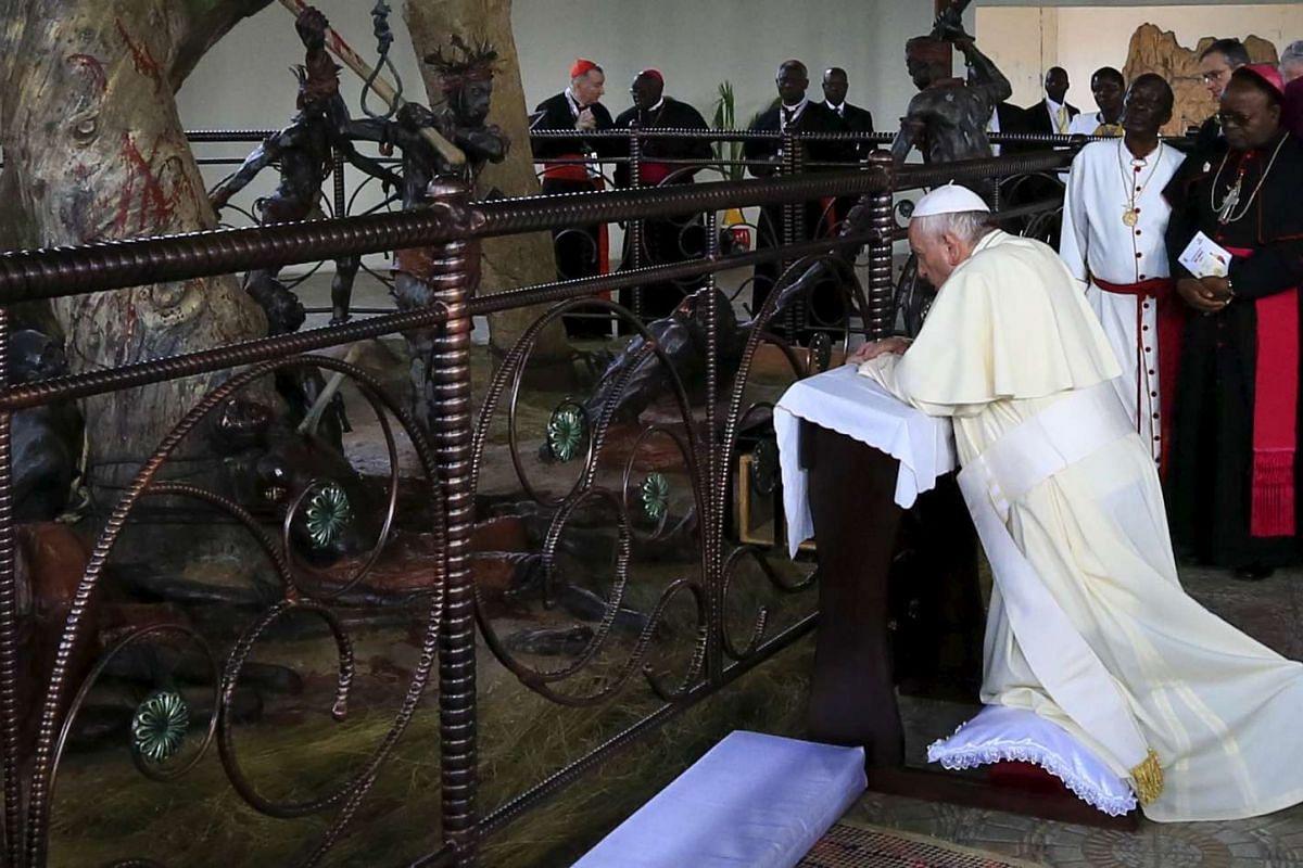 Pope Francis praying at the Anglican martyrs' shrine in Namugongo, near the Ugandan capital, on Nov 28, 2015.