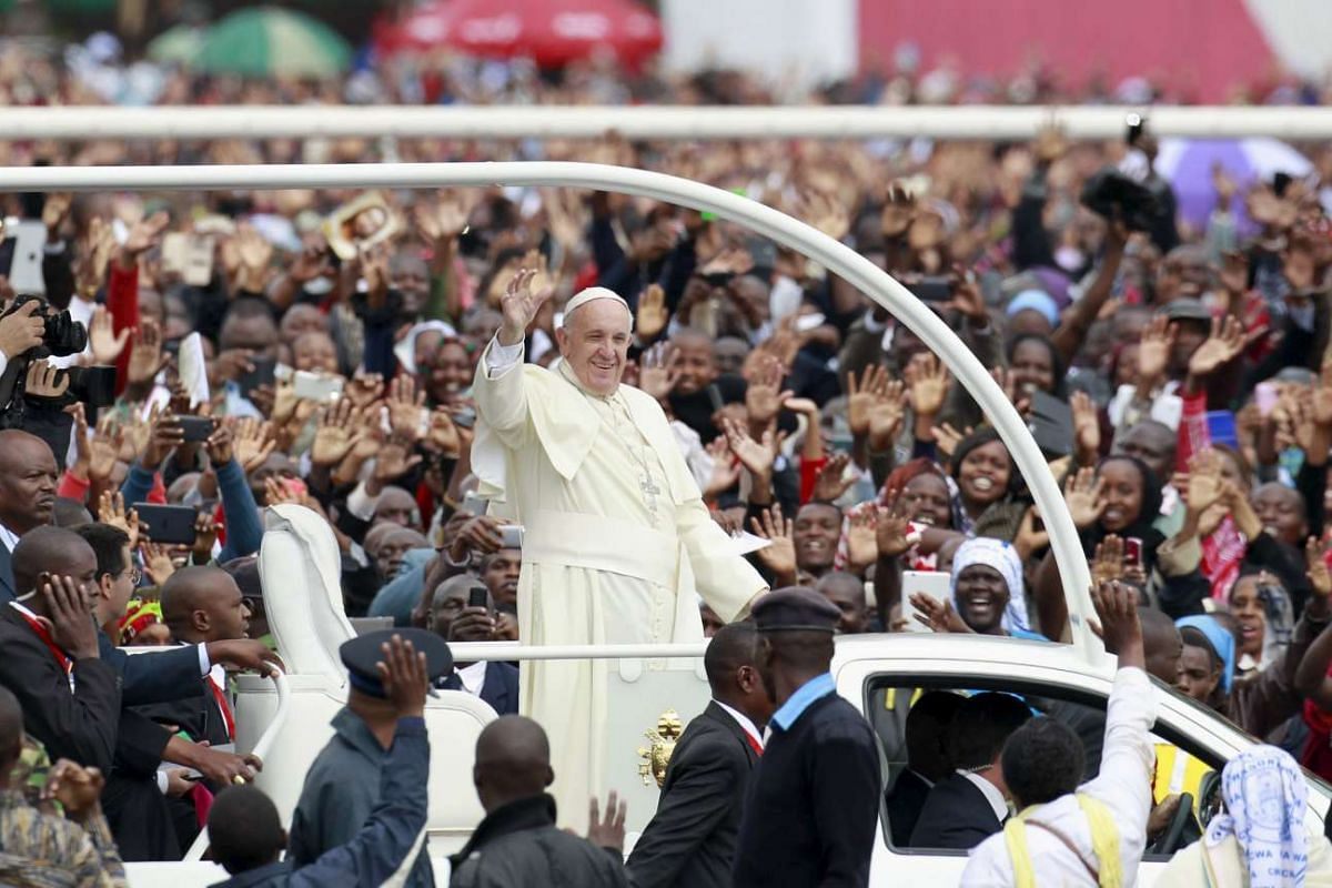 Pope Francis waving to the faithful as he arrives for a Papal mass in Kenya's capital Nairobi on Nov 26, 2015.