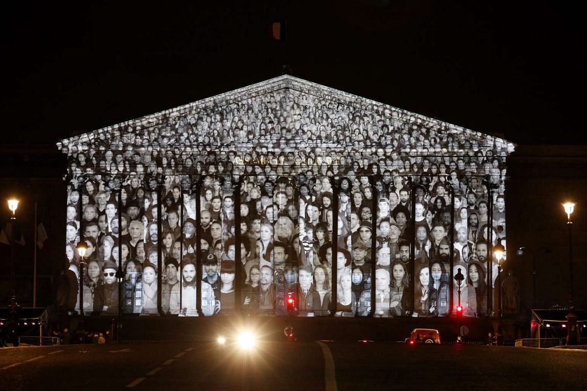 An artwork by French artist JR and US filmmaker Darren Aronofsky is projected onto the French National assembly (Parliament) on the eve of the COP21 climate conference in Paris, France, Nov 29 2015.