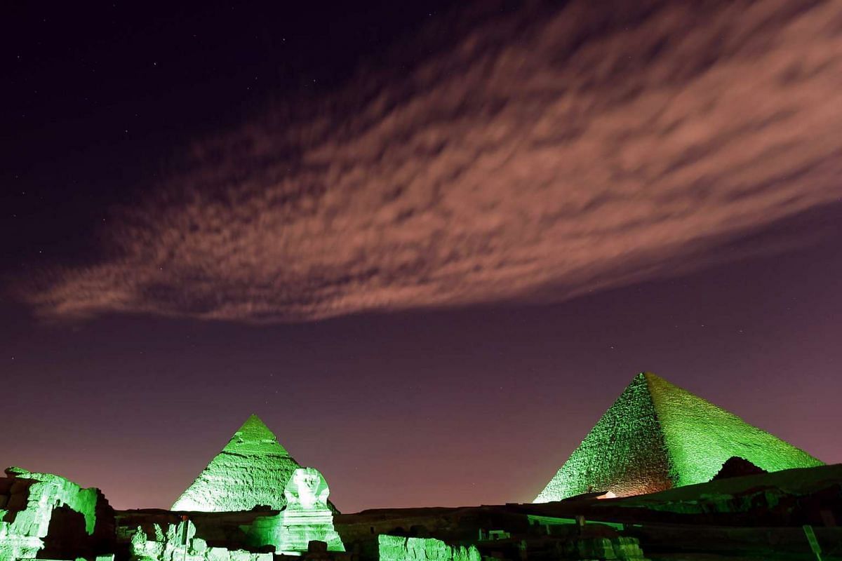 The Great Pyramids and Sphinx in Giza, Egypt, are lit in green on the occasion of the World Climate Conference held in France, Nov 30 2015