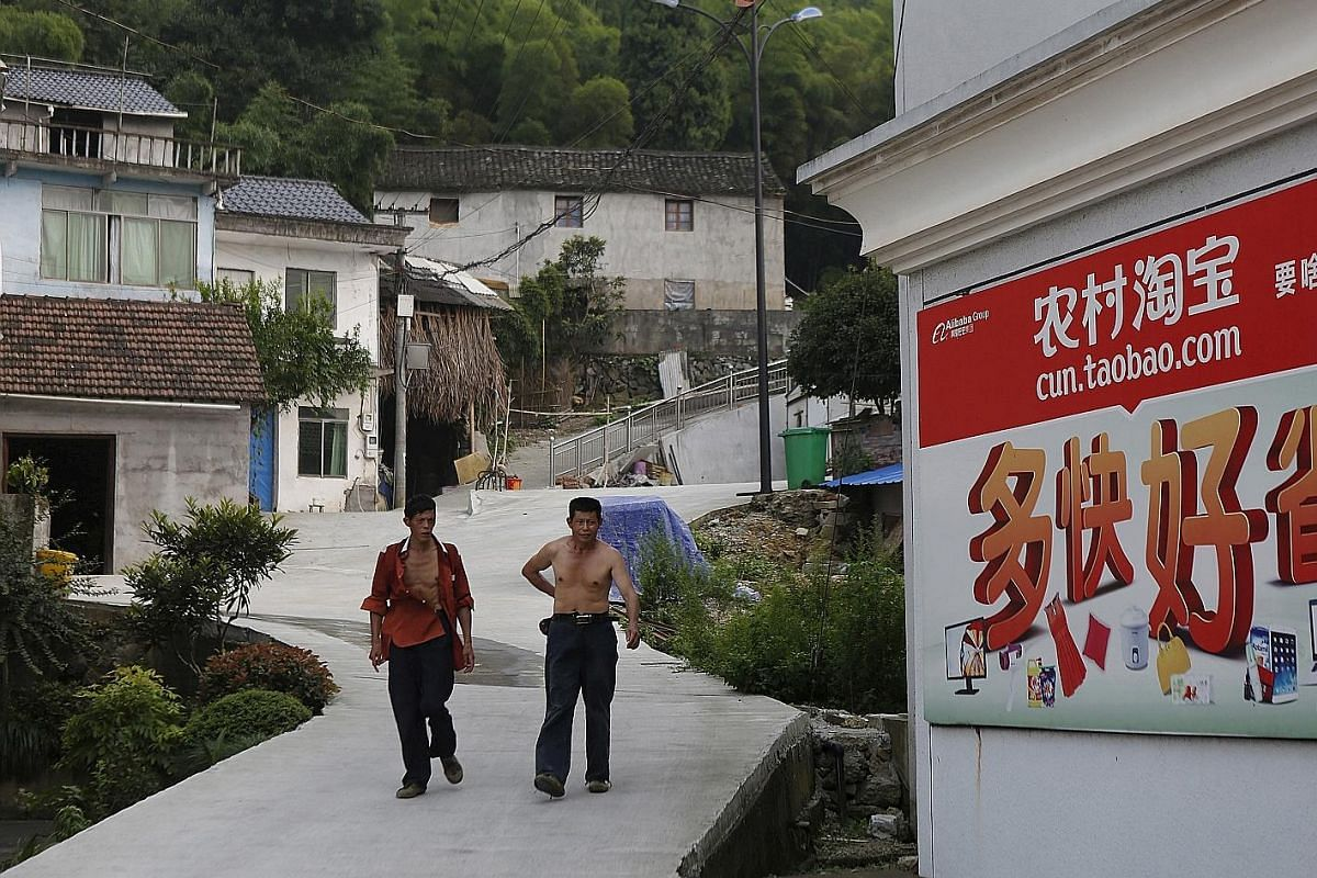 A customer checking a parcel at the Alibaba rural service centre in Jinjia village. Products ordered online are transported to such centres which are often located in the villages' main convenience stores. This means rural consumers can get their onl