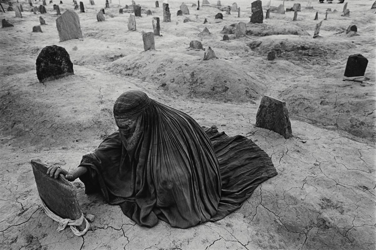 Mourning a brother killed by a Taleban rocket, Afghanistan, 1996.