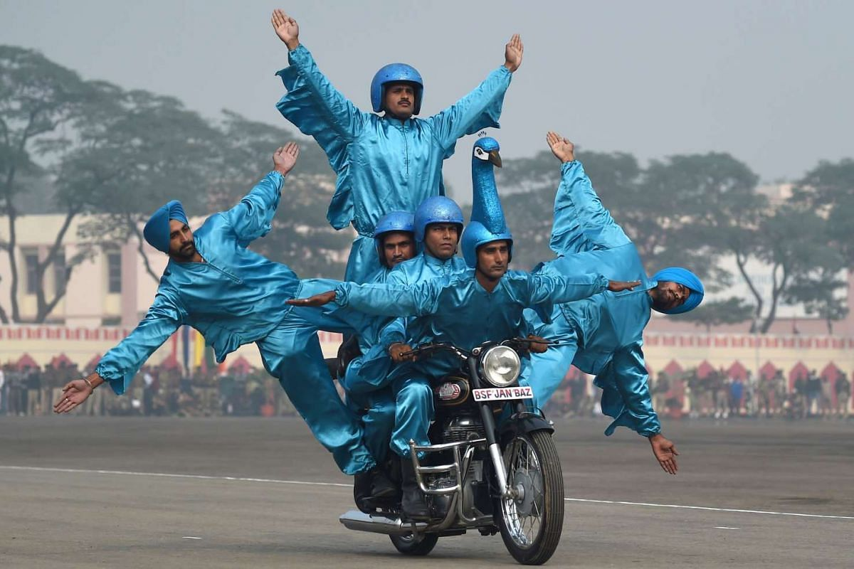 Members of the Indian Border Security Force (BSF) demonstrating their skills during the BSF Golden Jubilee Day celebration in New Delhi on Dec 1, 2015.
