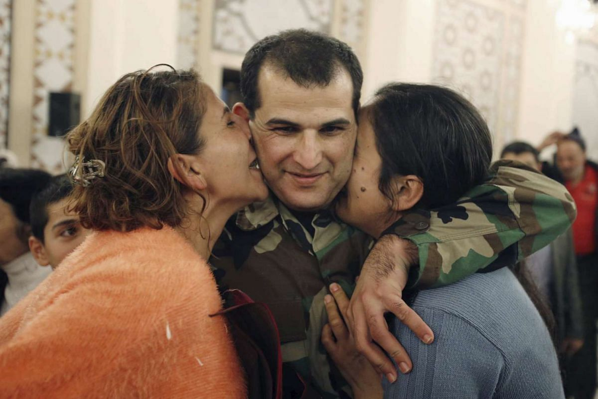 A Lebanese army soldier who was captured by the Al-Qaeda-linked Nusra Front in Arsal, being greeted by his loved ones on his arrival in Beirut on Dec 1, 2015.
