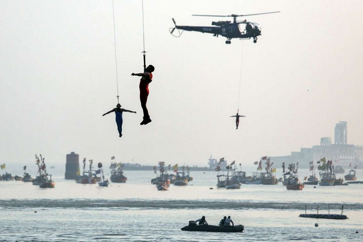 Indian Navy marine commandos demonstrates their rescue operation skills during a rehersal for Navy Day celebrations in Mumbai, India, Dec 2 2015.