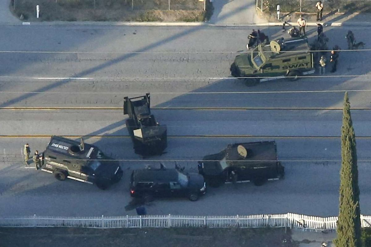 An SUV with its windows shot out that police suspect was the getaway vehicle from at the scene of a shooting in San Bernardino, California, Dec 2, 2015.