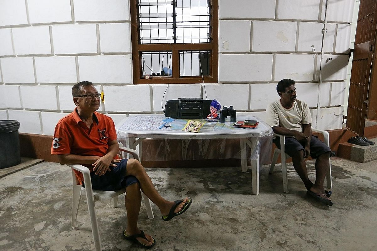 Right: Mr Uthrapathi and Mr Lee Kwang Liang (with backpack) arrive at Raffles Lighthouse by ferry to relieve their colleagues and start their shift. Far right: Mr Uthrapathi conjures up a meal of fried chicken, sambal ikan bilis, vegetable soup and r