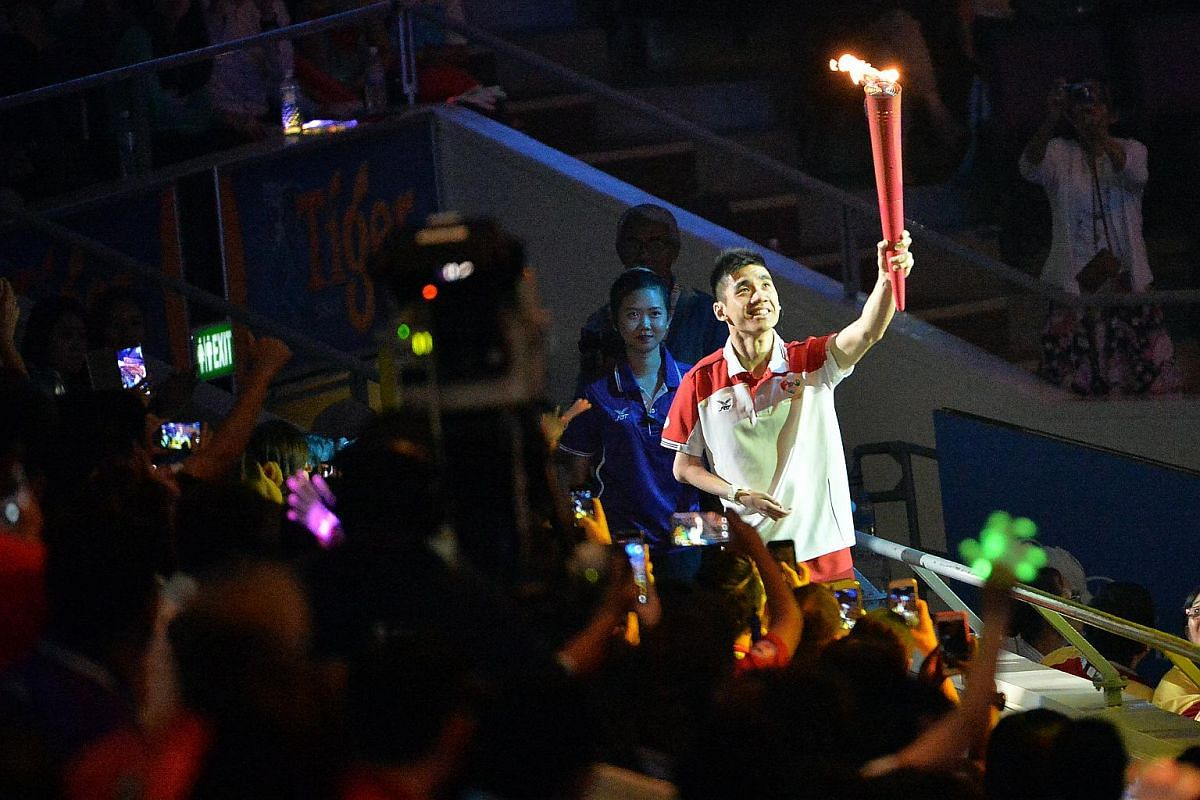 Badminton player Tay Wei Ming was one of the three final torchbearers.