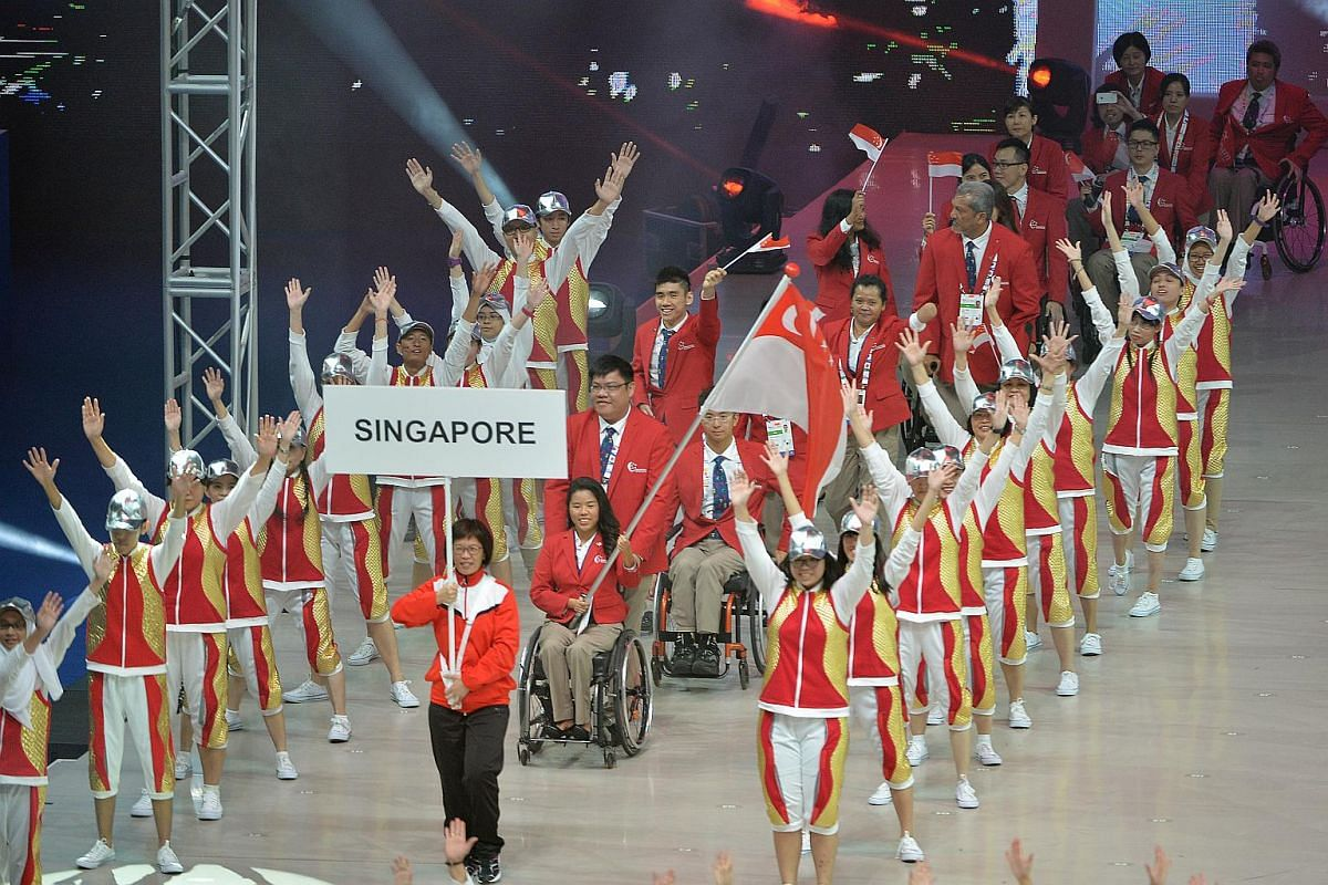 Team Singapore marching in during last night's opening ceremony at the Singapore Indoor Stadium.